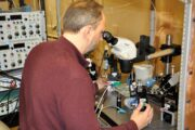David Schulz examines neurons under a microscope