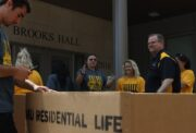 MU Chancellor Alexander N. Cartwright volunteers during move in day at Mizzou. This year, more than 6,700 students are choosing to live in residential halls.